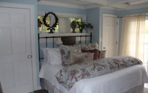 Bedroom of cottage 5 at Hope and Glory Inn
