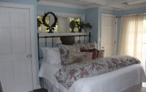 The bedroom inside Cottage 5 at the Hope and Glory Inn