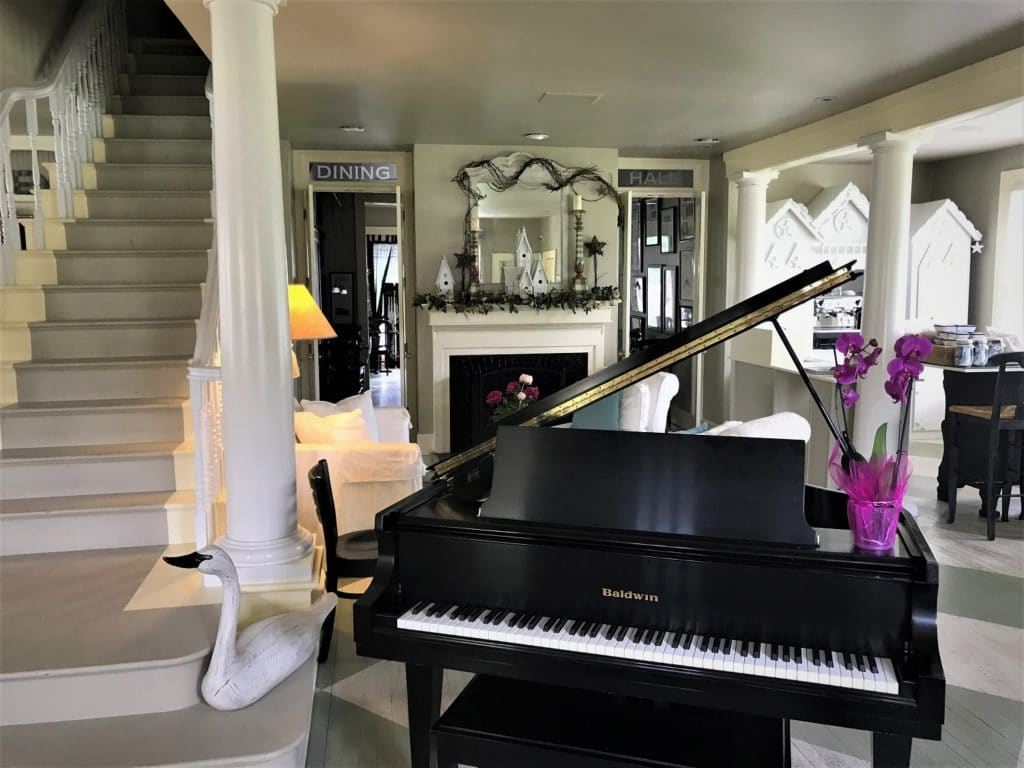 The piano in the lobby of the Hope and Glory Inn