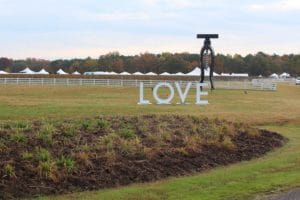 "The ""LOVE"" sign and giant corkscrew at The Dog and Oyster Vineyard — a great place for fall getaways in Virginia"