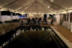 People sitting by the pool for a Virginia wedding reception
