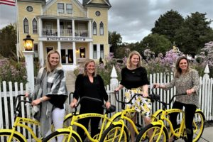Women with bicycles in front of the Hope and Glory Inn on a girls' getaway in Virginia