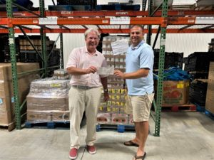 Dudley Patteson of the Dog and Oyster Vineyard presents check to Mark Kleinschmidt of Healthy Harvest Food Bank